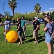 Dr. Kortencamp and POEM students on UA mall during solar system modeling