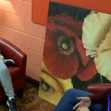 young child being interviewed by woman broadcaster