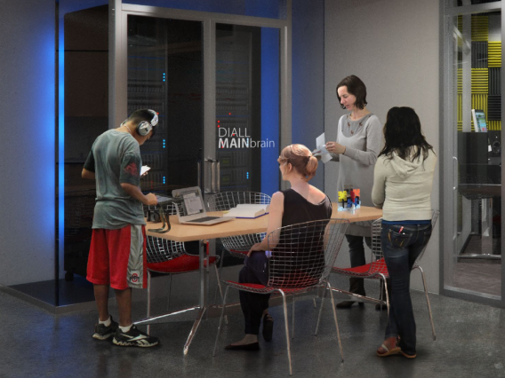Students standing around a desk