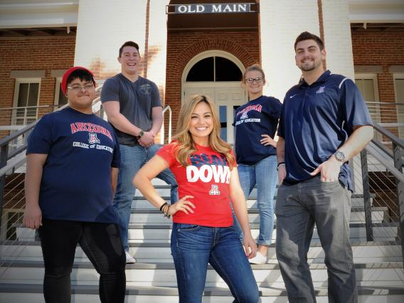 Students posing in front of Old Main