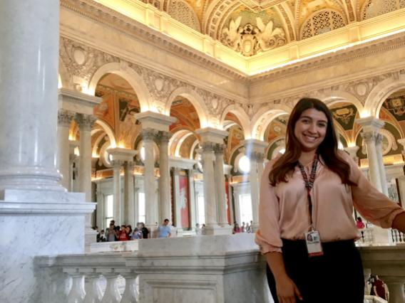 Monique Perez standing in the library of congress