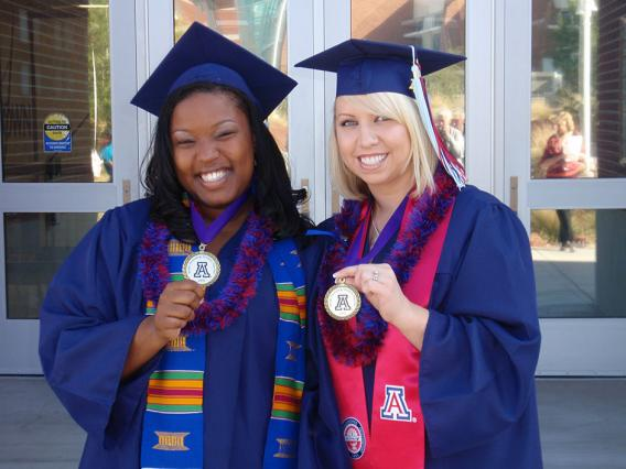 two female college of education grads