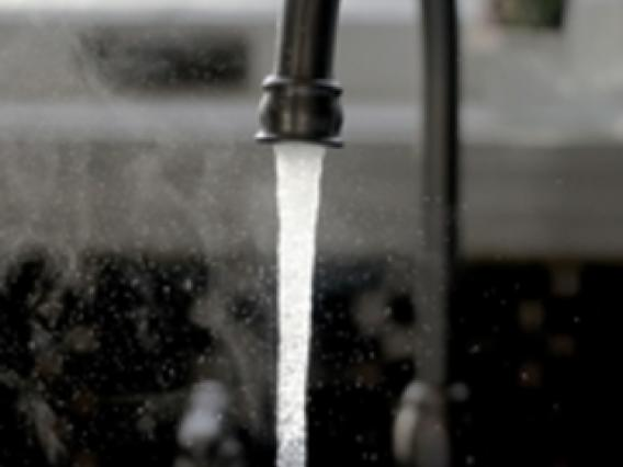 close up of water running out of a water spout