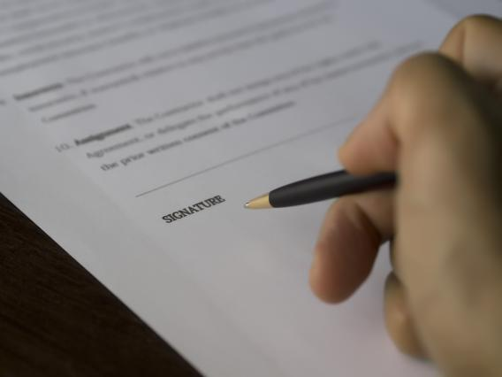 signing a form