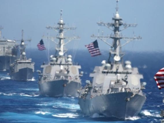 fleet of navy ships at sea