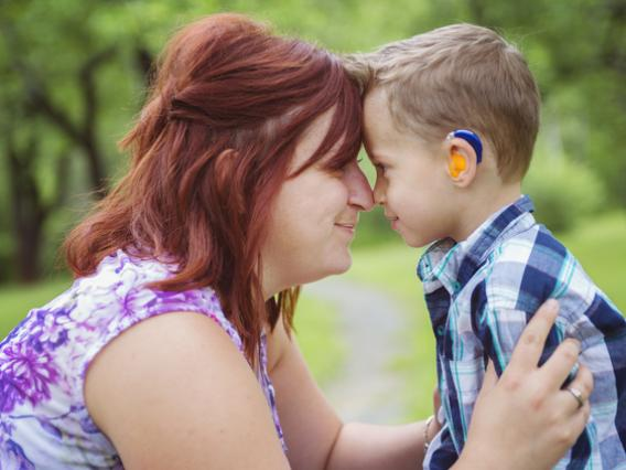 woman with little boy in hearing aids