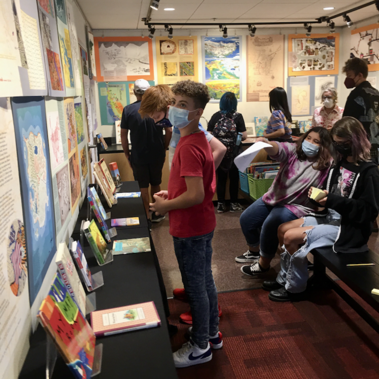 several patrons browsing a library exhibit