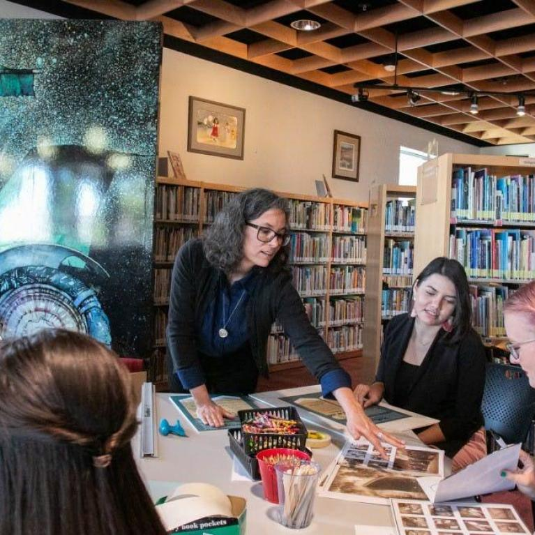 Rebecca Ballenger works with her students to prepare books for their silent books exhibit
