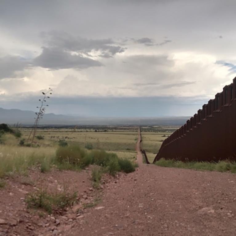 desert scene with border wall