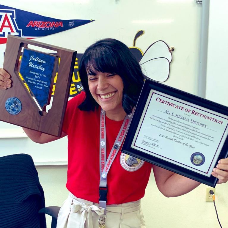 Juliana Urtebey holding her awards