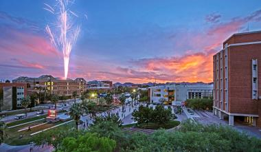 Arizona campus aerial photograph with fireworks in the distance