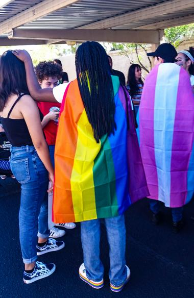 young adults wearing rainbow colors