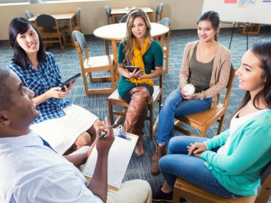 diverse group sitting on chairs in a circle
