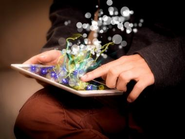 hands holding an ipad with colorful illustration