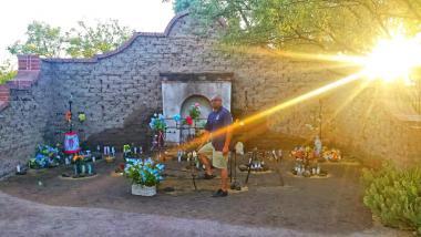 Jesus Jaime-Diaz standing in front of Tucson's El Tiradito Wishing Shrine